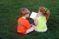 139391_a_boy_a_girl_and_a_book